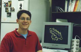 Picture of Dr. Shaw at a computer terminal